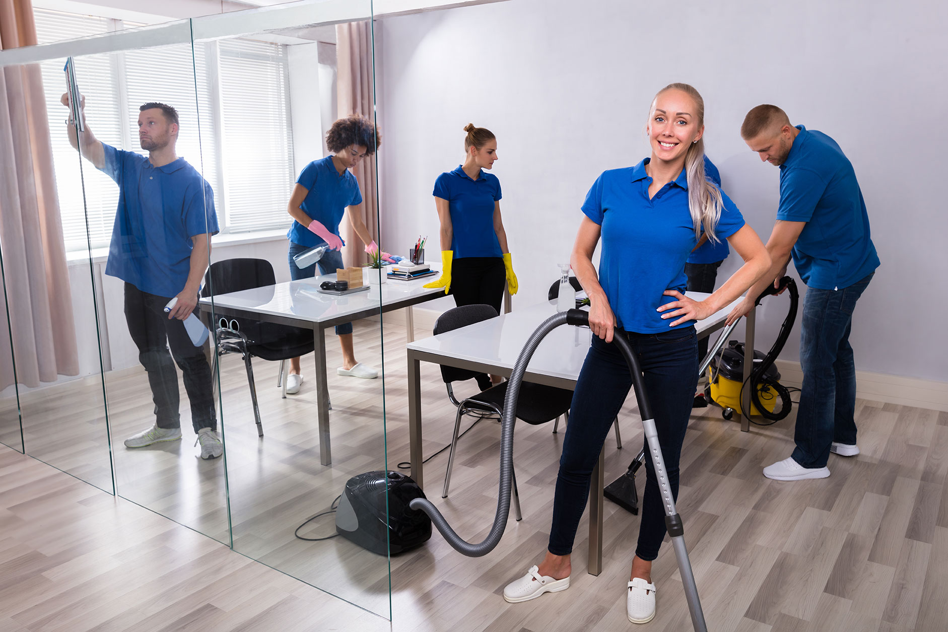 Commercial cleaning team in office