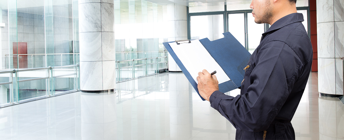 Man performing Quality Control Inspection with clipboard