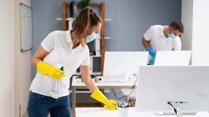 Office cleaners with masks and gloves