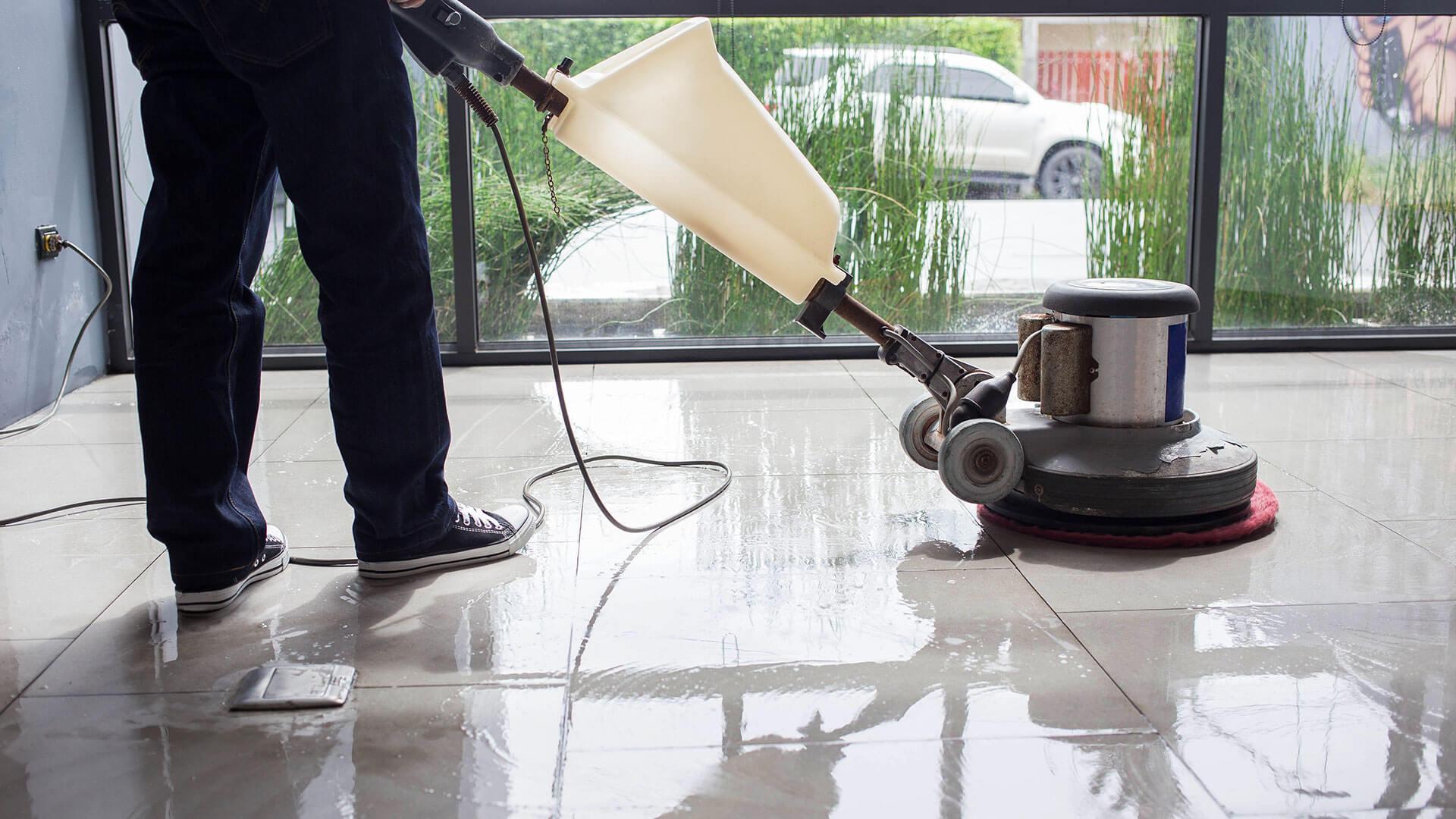 Worker polishing floor